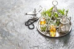 Tea glasses and pot, arabian lantern and rosary. Islamic holiday Stock Photography