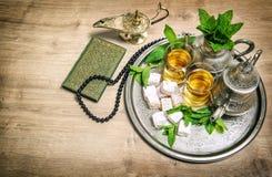 Tea glasses pot. Oriental hospitality concept. Islamic holidays. Tea glasses and pot. Oriental hospitality concept. Islamic holidays decoration. Ramadan kareem Stock Photography