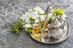 Tea glasses pot. Oriental table decoration flowers Stock Photography