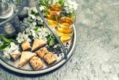 Tea glasses and pot, traditional cookies baklava. Islamic holida Royalty Free Stock Image