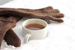 Tea with gloves Stock Photos
