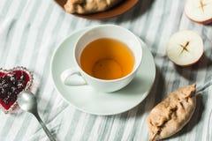 Tea at the grandmother`s, tea with pancakes and pies with apples. Tea at the grandmother`s, tea with pancakes and pies Stock Photos