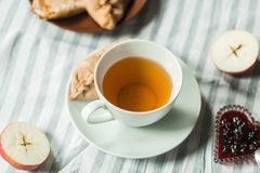 Tea at the grandmother`s, tea with pancakes and pies with apples Royalty Free Stock Photos