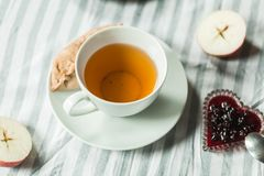 Tea at the grandmother`s, tea with pancakes and pies with apples Stock Photography