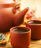 Tea. Green tea in Chinese cup and teapot Royalty Free Stock Images