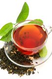 Tea and green leaf Royalty Free Stock Images