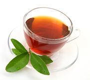 Tea and green leaf Stock Images