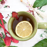 Tea in a green mug Royalty Free Stock Images