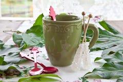 Tea in a green mug Stock Photo