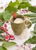 Tea in a green mug Stock Photography