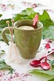 Tea in a green mug Stock Photos