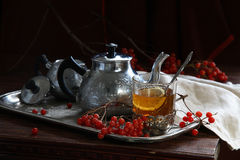 Tea with a guelder-rose and a lemon. Still-life with a cup of tea, a guelder-rose and a lemon royalty free stock images