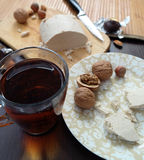 Tea with halva and nuts on table Royalty Free Stock Images