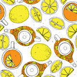 Tea hand draw seamless pattern with teapot, lemons and cup. Sketched textured background. Royalty Free Stock Photo