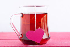 Tea with heart shaped tea bag Royalty Free Stock Images