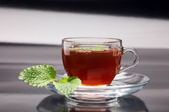 Tea. Herbal tea. Mint leaf. Tea in a glass cup, mint leaves, Stock Photos