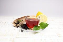 Tea. Herbal tea. Mint leaf. Tea in a glass cup, mint leaves, dried tea, sliced lime. herbs on a slate plate in a restaurant or tea Royalty Free Stock Photo