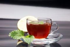 Tea. Herbal tea. Mint leaf. Tea in a glass cup, mint leaves, dried tea, sliced lime. herbs on a slate plate in a restaurant or tea Royalty Free Stock Photos
