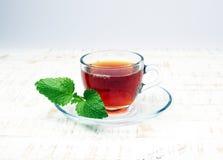 Tea. Herbal tea. Mint leaf. Tea in a glass cup, mint leaves, dried tea, sliced lime. herbs on a slate plate in a restaurant or tea Stock Image