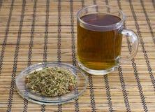 Tea on herbs Stock Images