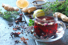 Tea from herbs with ginger, lemon in a rustic style Stock Photo