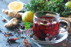 Tea from herbs with ginger, lemon in a rustic style Royalty Free Stock Photos