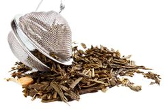 Tea herbs with strainer Royalty Free Stock Photography