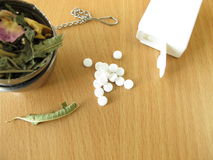 Tea herbs and sweetener tablets stock images