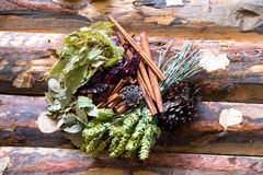 Tea and herbs on wooden table Royalty Free Stock Photo