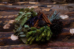 Tea and herbs on wooden table Stock Images