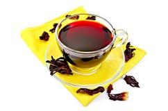Tea hibiscus on yellow napkin Stock Photos