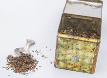 Tea. Himalayan tea in old tea tin with antique silver teaspoon and some tealeaves Royalty Free Stock Images