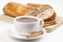 Tea and home sweet rolls with cinnamon Stock Image