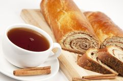 Tea and home sweet rolls with cinnamon filling Royalty Free Stock Images