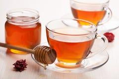 Tea with honey Stock Photos