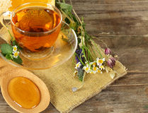 Tea and honey on background Royalty Free Stock Images