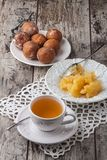 Tea with honey and cake donuts on wood table Royalty Free Stock Photos