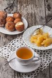 Tea with honey and cake donuts on wood table Royalty Free Stock Images