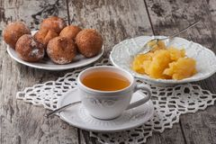 Tea with honey and cake donuts on wood table Royalty Free Stock Image