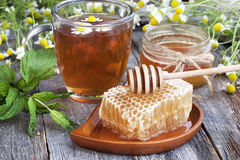Tea with honey Stock Images