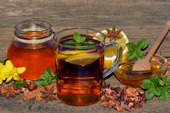 Tea with honey, dried fruit slices, lemon and mint Stock Image