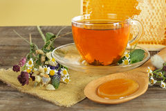 Tea, honey and flowers Royalty Free Stock Photos