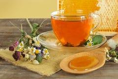 Tea, honey and flowers Royalty Free Stock Photos