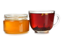 Tea and honey in glass Stock Photography