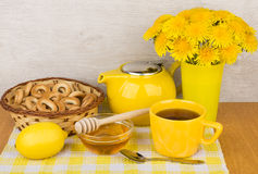 Tea with honey and lemon, bagels and bouquet Royalty Free Stock Photos