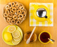 Tea with honey and lemon, bagels in wicker basket Stock Image