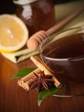 Tea with honey, lemon and cinnamon Stock Photos