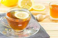 The tea with  honey  and lemon on wood background,warm toning, selec Stock Photography