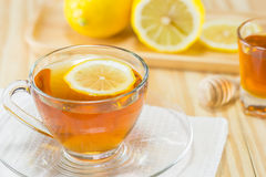The tea with  honey  and lemon on wood background,warm toning, selec Royalty Free Stock Images