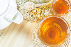 The tea with  honey  and teapot on wood background,warm toning, sele Royalty Free Stock Photos